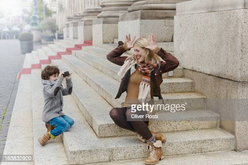 Mischievous mother with son on stairs : Stock Photo