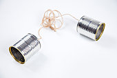 Old fashioned phone cans with tangled lines.