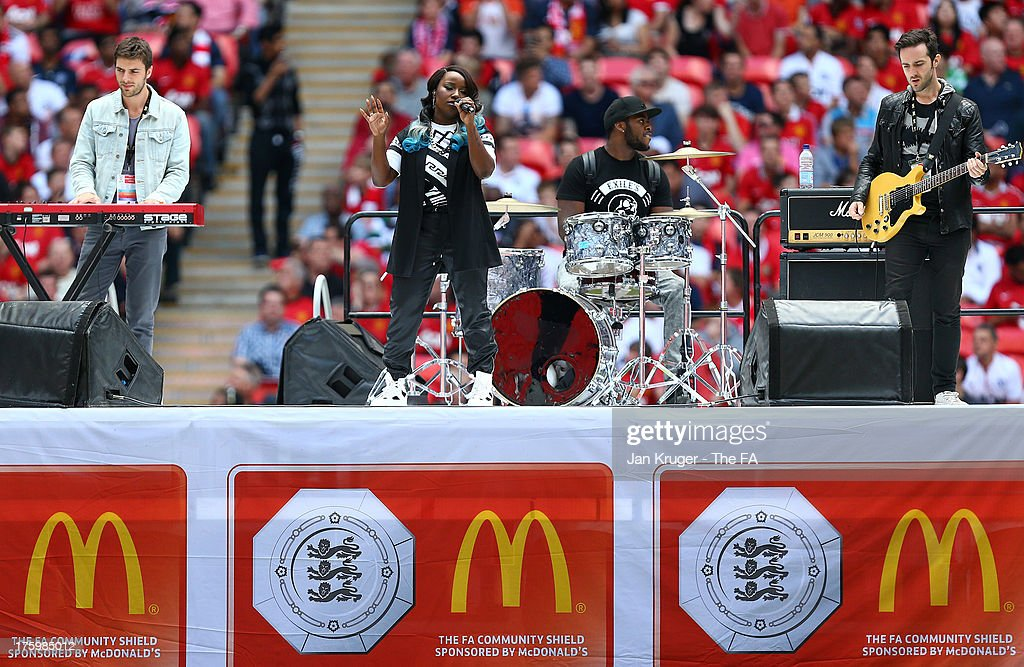 Misha B performs ahead of the FA Community Shield match between Manchester United and Wigan Athletic at Wembley Stadium on August 11 2013 in London...
