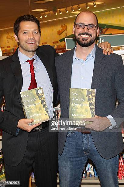 Misha Collins and Matthew Thomas attend the Matthew Thomas at Barnes Noble bookstore at The Grove on September 28 2014 in Los Angeles California