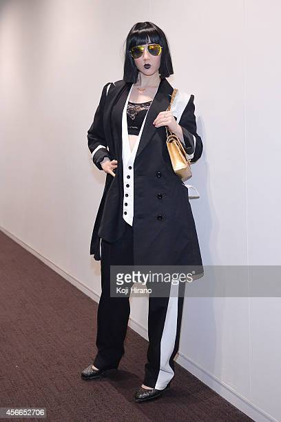 Misha Janette wears a suits by LIMI feu at MercedesBenz Fashion Week Tokyo Autumn/Winter 2014 at Shibuya Hikarie on March 22 2014 in Tokyo Japan