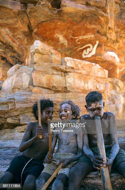 Mishak Matthew Jeremiah playing sticks and didjeridu at Dukalaljarranj an important clan sacred site in the rock country central Arnhem Land