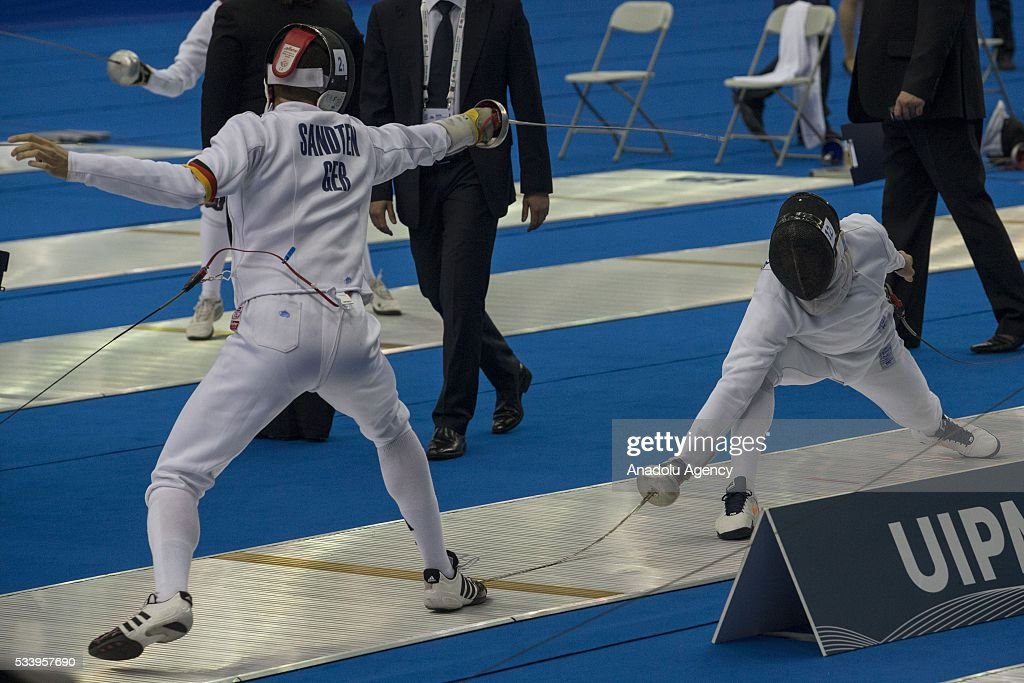 Mishchenko Vladislav (Ukraine)(Right) and Sandten Matthias (Germany) during the men's relay World Championship in modern pentathlon in Moscow in Olympic Sports Complex in Moscow, Russia, on May 24, 2016.