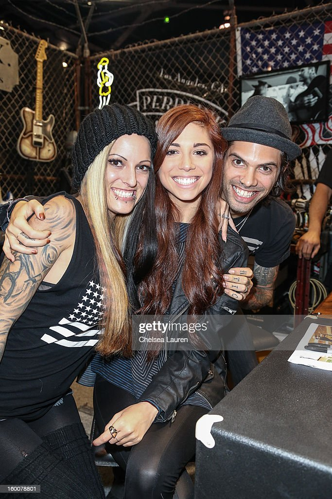 Misi Perri, singer / songwriter <a gi-track='captionPersonalityLinkClicked' href=/galleries/search?phrase=Christina+Perri&family=editorial&specificpeople=7285432 ng-click='$event.stopPropagation()'>Christina Perri</a> and guitarist Nick Perri attend the 2013 NAMM show at Anaheim Convention Center on January 25, 2013 in Anaheim, California.