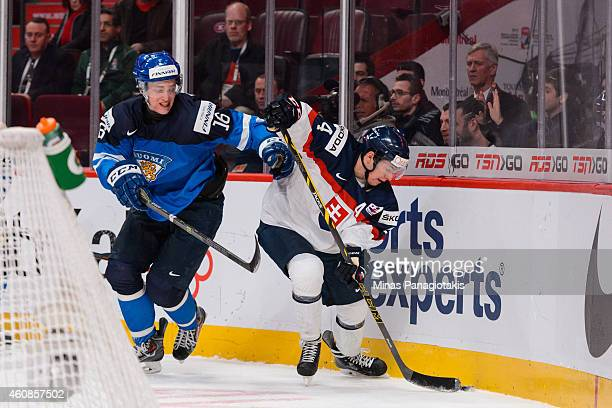 Mislav Rosandic of Team Slovakia tries to play the puck near the boards with Mikko Rantanen of Team Finland close behind during the 2015 IIHF World...