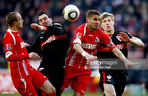 Miso Brecko and Youssef Mohamad of Koeln battle for the ball with Timo Gebhart and Pavel Pogrebnyak of Stuttgart during the Bundesliga match between...