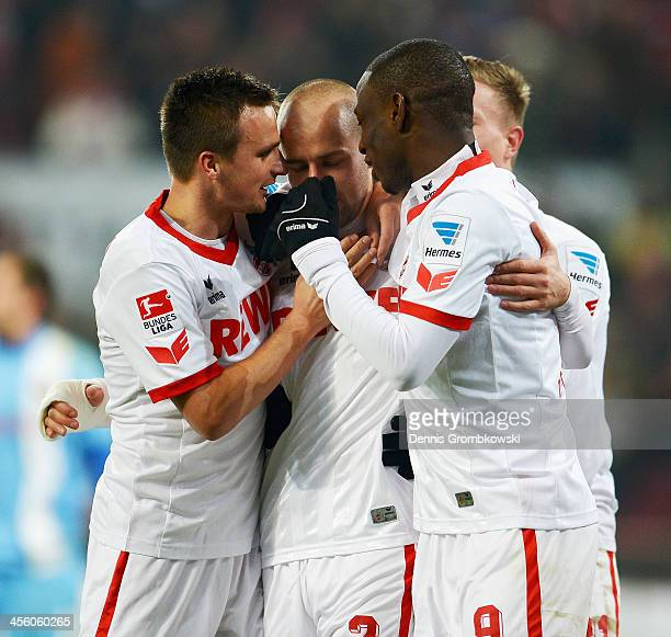 Miso Brecko of 1 FC Koeln celebrates with teammates after scoring his team's third goal during the Second Bundesliga match between 1 FC Koeln and...