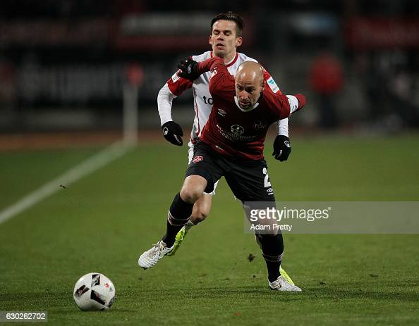 Miso Brecko of 1 FC Nuernberg cis challenged by Zoltan Stieber of 1 FC Kaiserslautern during the Second Bundesliga match between 1 FC Nuernberg and 1...