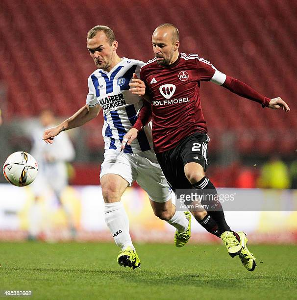 Miso Brecko of 1 FC Nuernberg is challenged by Erwin Hoffer of Karlsruher SC during the 2 Bundesliga match between 1 FC Nuernberg and Karlsruher SC...