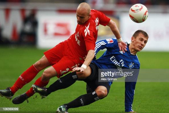 Miso Brecko of Koeln is challenged by Robert Tesche of Hamburg during the Bundesliga match between 1 FC Koeln and Hamburger SV at the...
