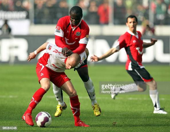 Miso Brecko of Koeln vie for the ball with Didier Ya Konan of Hannover during the Bundesliga match between Hannover 96 and 1 FC Koeln at AWD Arena on...