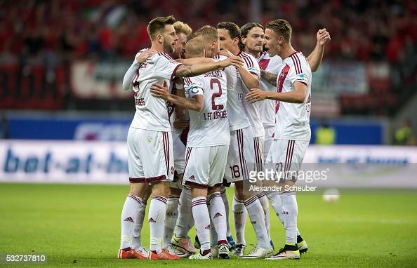 Miso Brecko of Nuernberg Hanno Behrens of Nuernberg and Ondrej Petrak of Nuernberg celebrate the first goal for the team during the bundesliga...
