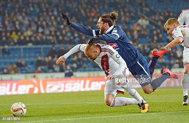 Miso Brecko of Nuernberg tackles David Ulm of Bielefeld during the Second Bundesliga match between Arminia Bielefeld and 1 FC Nuernberg at Schueco...