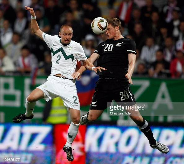 Miso Brecko of Slovenia and Chris Wood of New Zealand go for a header during the International Friendly match between Slovenia and New Zealand at the...