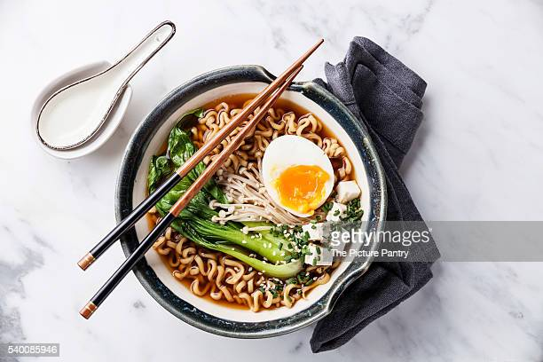 Miso Ramen Asian noodles with egg, enoki and pak choi cabbage in