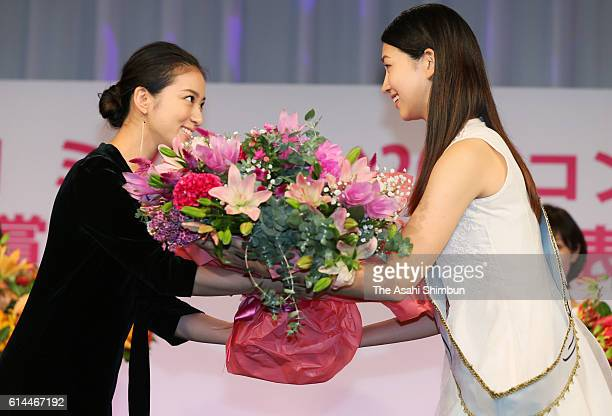 Miss 20s Contest winner Hitomi Korenaga receives a flower bouquet from actress Emi Takei during the Miss 20s Contest award ceremony on September 29...