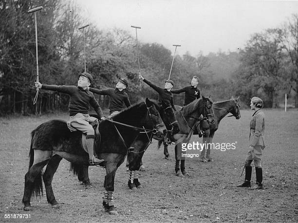 Miss A B Kilroy teaches schoolboys the game of polo in her riding school at Bradfield About 1935 Photograph