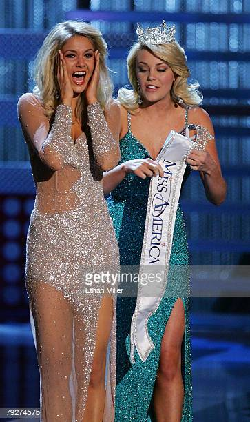 Miss America 2007 Lauren Nelson gives the Miss America sash to Kirsten Haglund Miss Michigan after she won the 2008 Miss America Pageant at the...
