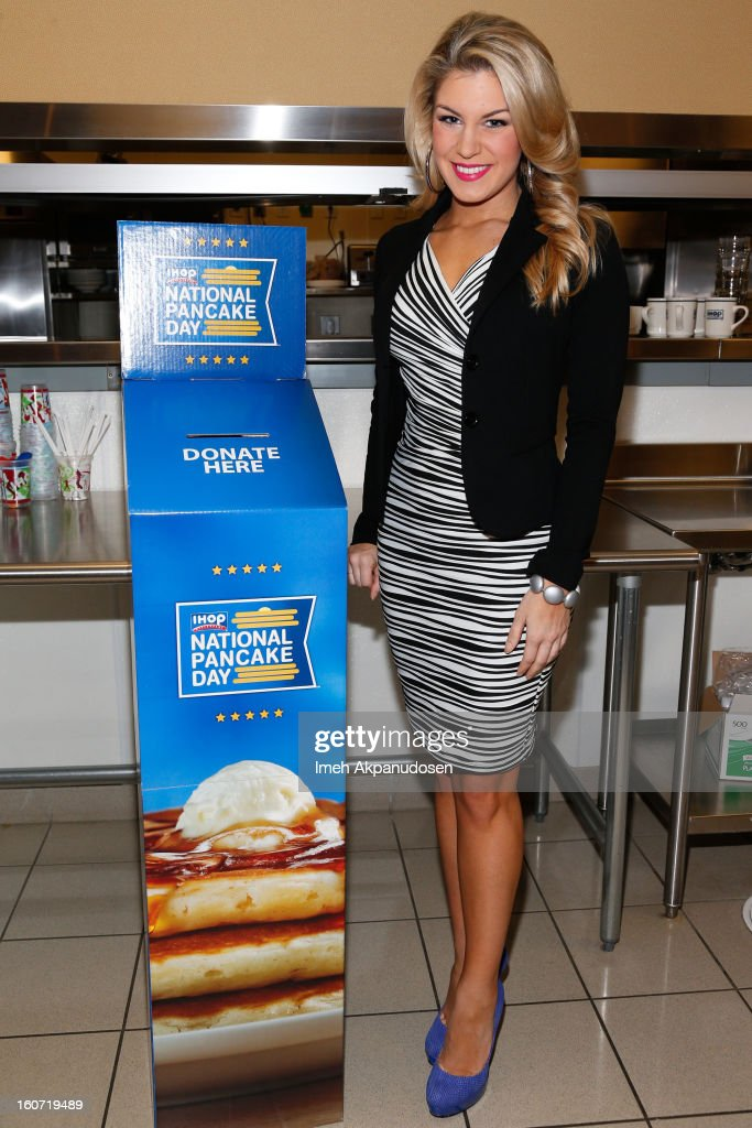 Miss America 2013 Mallory Hagan learns how to make a pancake at IHOP's Headquarters on February 4, 2013 in Los Angeles, California.