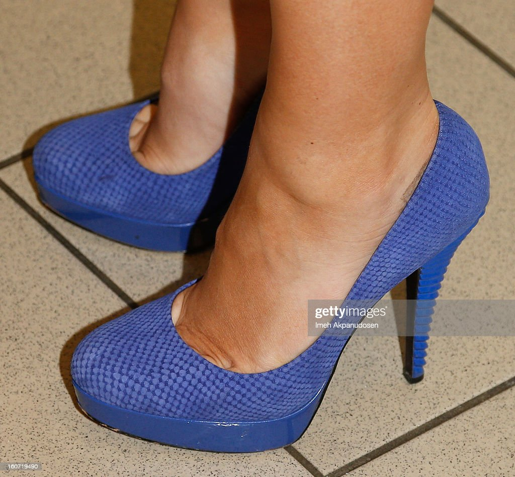 Miss America 2013 Mallory Hagan (shoe detail) learns how to make a pancake at IHOP's Headquarters on February 4, 2013 in Los Angeles, California.