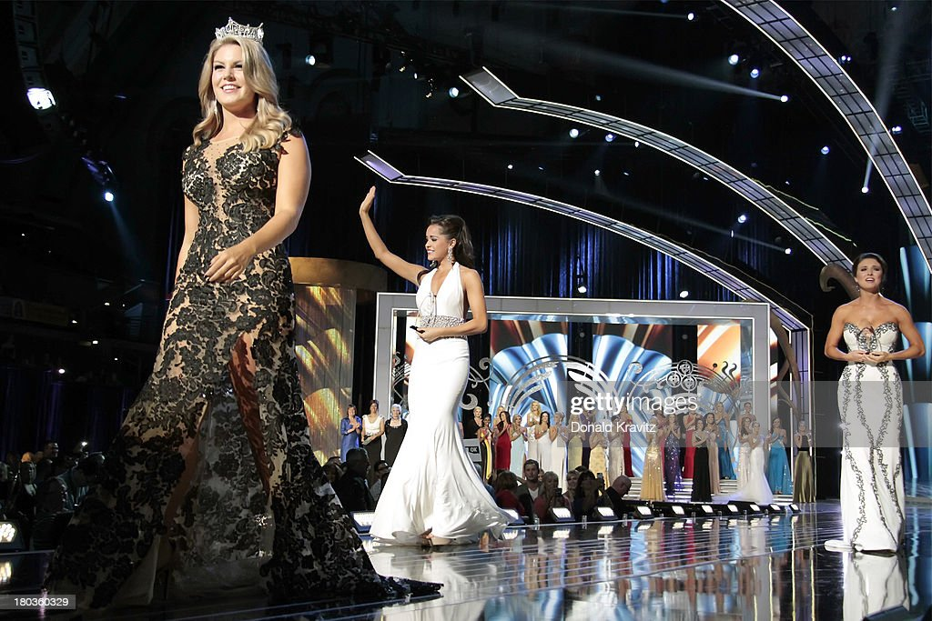 Miss America 2013, <a gi-track='captionPersonalityLinkClicked' href=/galleries/search?phrase=Mallory+Hagan&family=editorial&specificpeople=9408105 ng-click='$event.stopPropagation()'>Mallory Hagan</a>, Miss Minnesota, Rebecca Yeh and Miss Oklahoma, Kelsey Griswold walk the runway as they attend 2014 Miss America News Competition - Preliminary Round 1 at Atlantic City Boardwalk Hall on September 11, 2013 in Atlantic City, New Jersey.