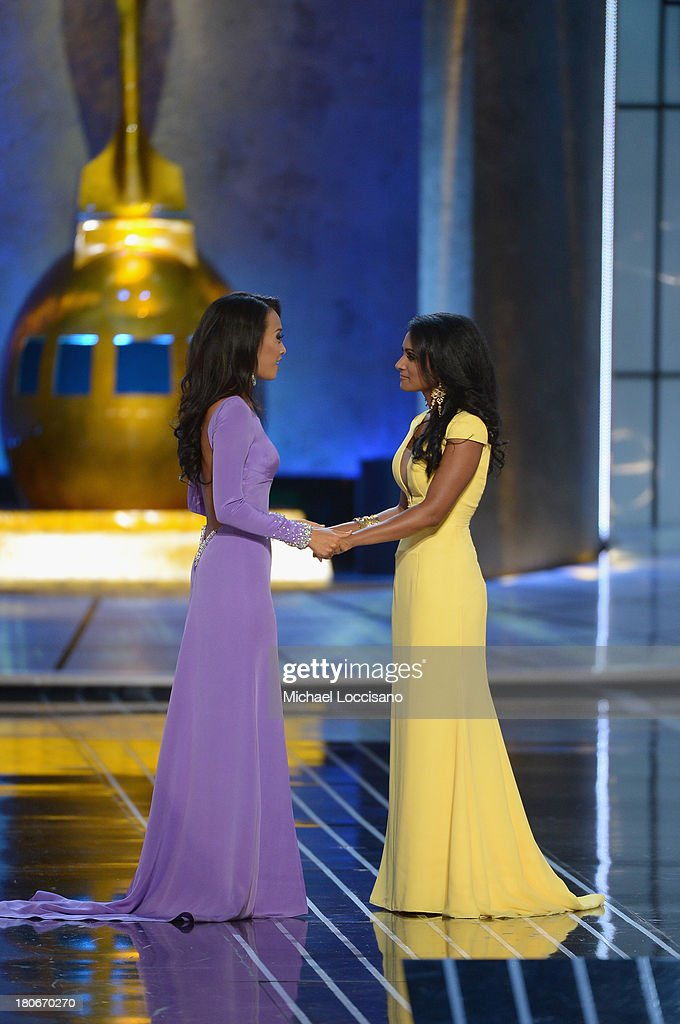 Miss America 2014 contestant Miss New York <a gi-track='captionPersonalityLinkClicked' href=/galleries/search?phrase=Nina+Davuluri&family=editorial&specificpeople=11331921 ng-click='$event.stopPropagation()'>Nina Davuluri</a> (R) and Miss California Crystal Lee embrace during the Miss America Competition at Boardwalk Hall Arena on September 15, 2013 in Atlantic City, New Jersey.