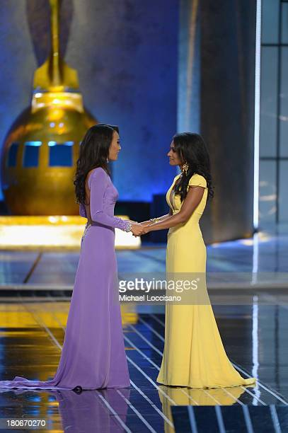 Miss America 2014 contestant Miss New York Nina Davuluri and Miss California Crystal Lee embrace during the Miss America Competition at Boardwalk...