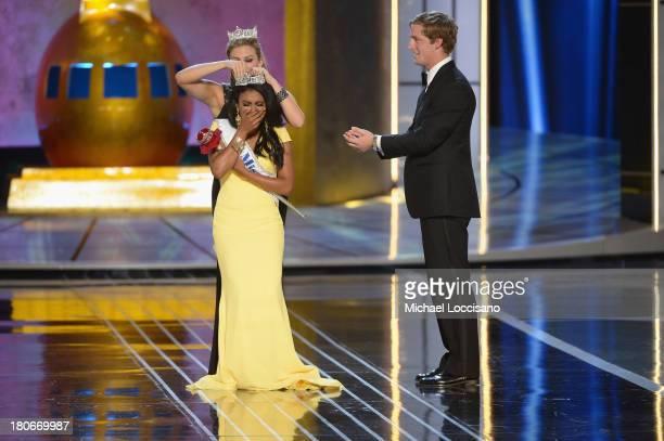 Miss America 2014 contestant Miss New York Nina Davuluri is crowned 2014 Miss America by 2013 Miss America Mallory Hagan during the Miss America...