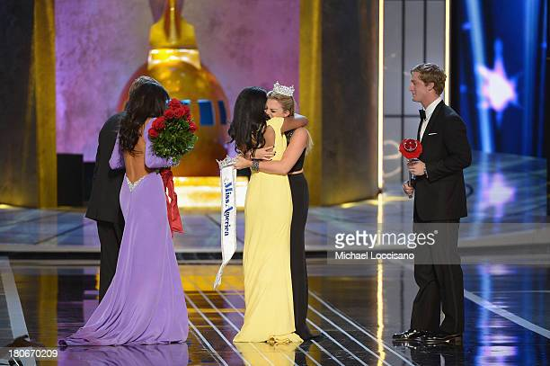 Miss America 2014 contestant Miss New York Nina Davuluri is crowned 2014 Miss America by 2013 Miss America Mallory Hagan as Miss California Crystal...