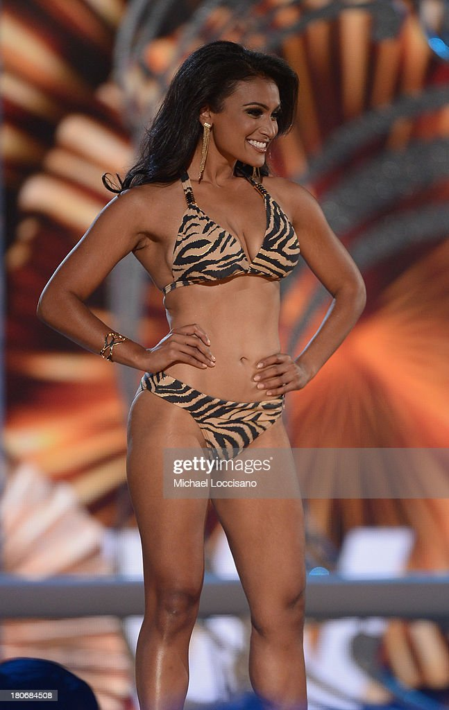 Miss America 2014 contestant Miss New York <a gi-track='captionPersonalityLinkClicked' href=/galleries/search?phrase=Nina+Davuluri&family=editorial&specificpeople=11331921 ng-click='$event.stopPropagation()'>Nina Davuluri</a> performs in the bathing suit portion of the 2014 Miss America Competition at Boardwalk Hall Arena on September 15, 2013 in Atlantic City, New Jersey.