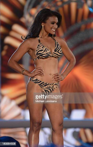 Miss America 2014 contestant Miss New York Nina Davuluri performs in the bathing suit portion of the 2014 Miss America Competition at Boardwalk Hall...