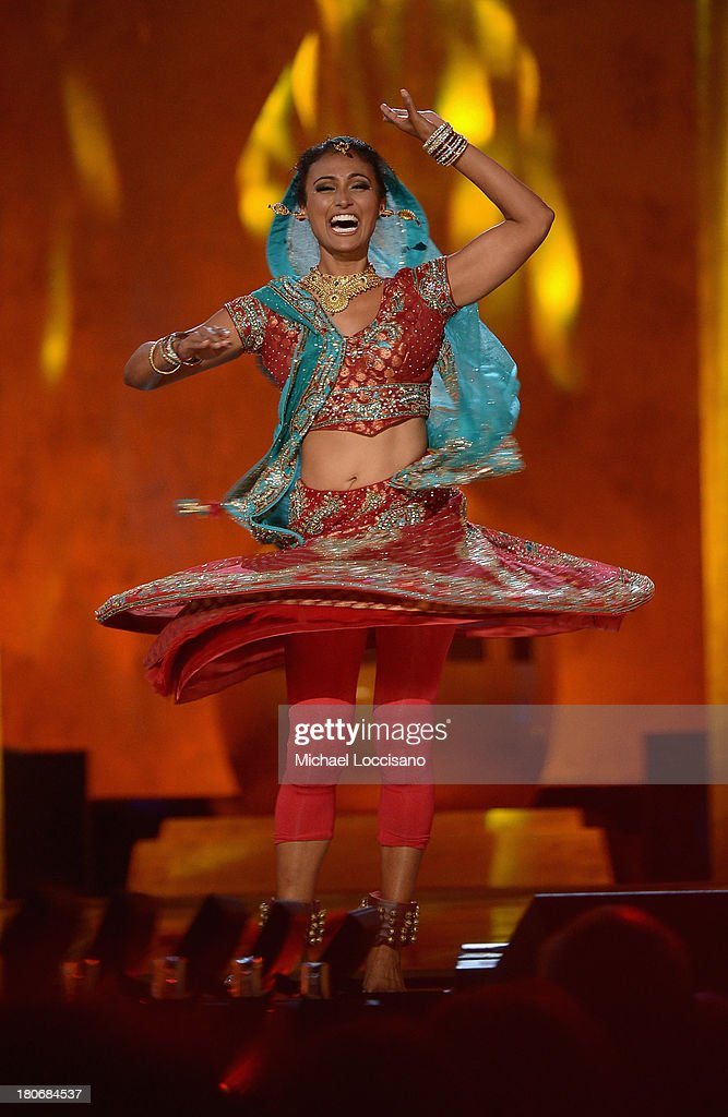 Miss America 2014 contestant Miss New York <a gi-track='captionPersonalityLinkClicked' href=/galleries/search?phrase=Nina+Davuluri&family=editorial&specificpeople=11331921 ng-click='$event.stopPropagation()'>Nina Davuluri</a> performs in the talent portion of the 2014 Miss America Competition at Boardwalk Hall Arena on September 15, 2013 in Atlantic City, New Jersey.