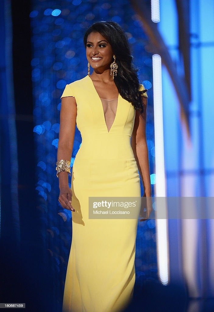 Miss America 2014 contestant Miss New York Nina Davuluri performs in the evening gown portion of the 2014 Miss America Competition at Boardwalk Hall Arena on September 15, 2013 in Atlantic City, New Jersey.