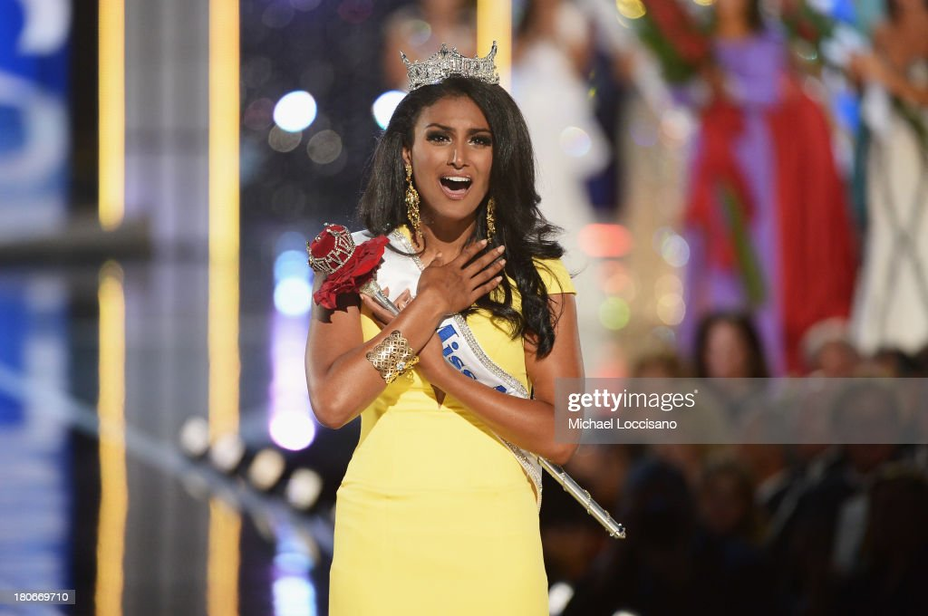 Miss America 2014 contestant Miss New York Nina Davuluri wins the 2014 Miss America Competition at Boardwalk Hall Arena on September 15 2013 in...