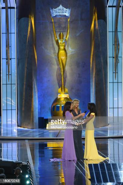 Miss America 2014 contestants Miss California Crystal Lee and Miss New York Nina Davuluri talk with cohost Lara Spencer during the Miss America...