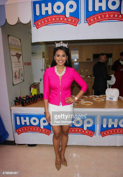 Miss America 2014 Nina Davuluri flips pancakes for Children's Miracle Network Hospitals on March 3 2014 in Los Angeles California