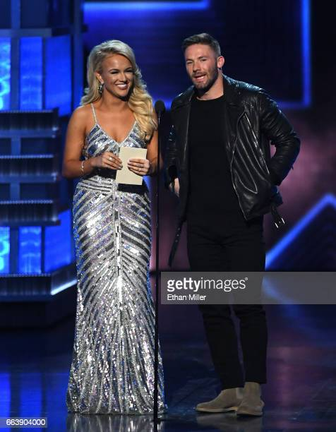 Miss America 2017 Savvy Shields and wide receiver Julian Edelman of the New England Patriots present the award for Female Vocalist of the Year...