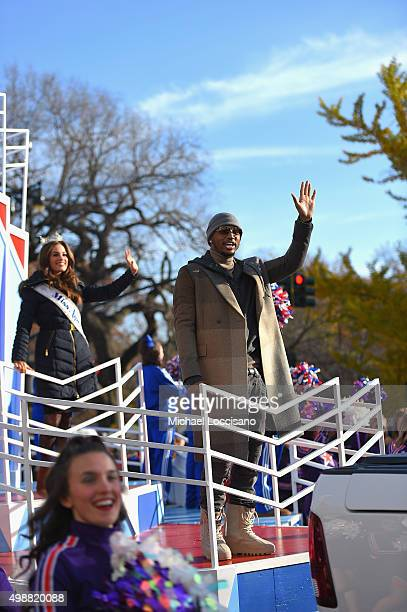 Miss America Betty Cantrell and rapper Trey Songz ride a float through the parade route during the 89th Annual Macy's Thanksgiving Day Parade on...