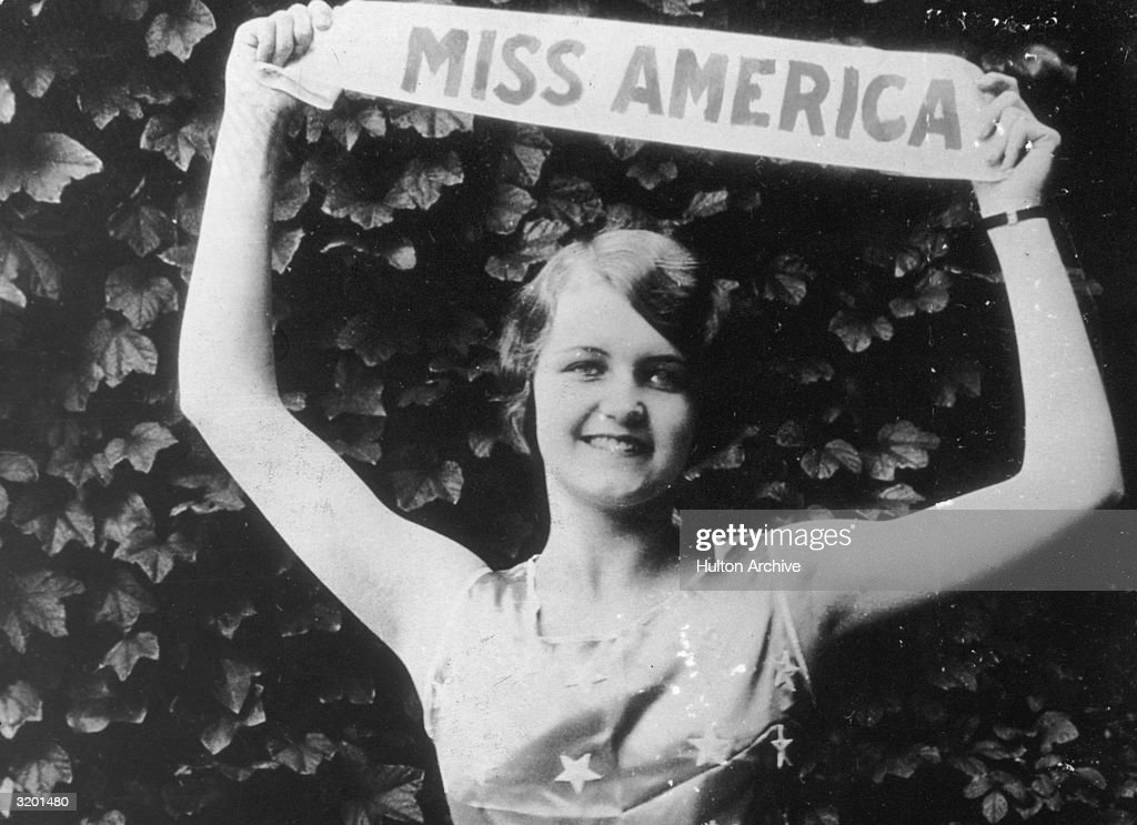 Miss America Lois Delander of Joliet Illinois holds up her title sash and wears a star print top celebrating her victory She served the longest time...