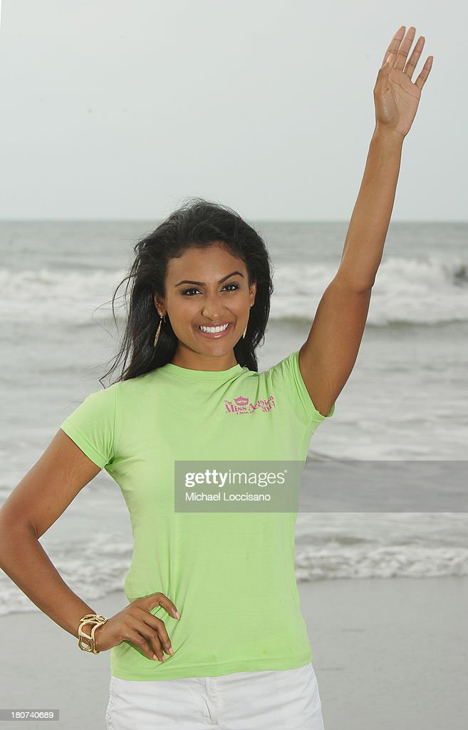 Miss America <a gi-track='captionPersonalityLinkClicked' href=/galleries/search?phrase=Nina+Davuluri&family=editorial&specificpeople=11331921 ng-click='$event.stopPropagation()'>Nina Davuluri</a> takes a dip In the Atlantic Ocean after being crowned Miss America 2014 at Atlantic City Boardwalk Hall on September 16, 2013 in Atlantic City, New Jersey.