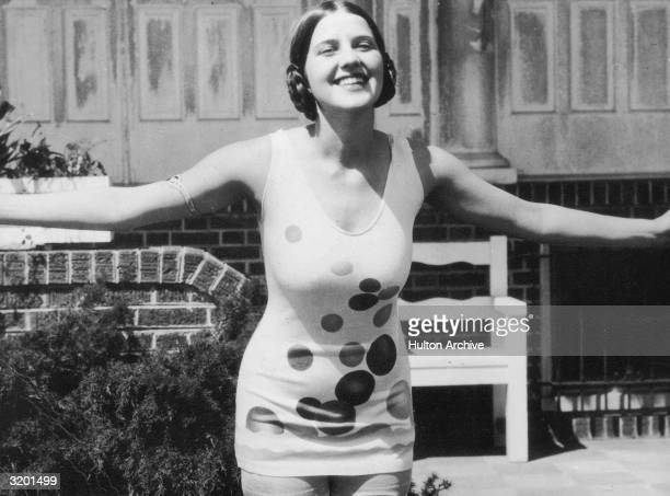 Miss America Norma Smallwood from Tulsa Oklahoma smiles while posing outdoors in a polkadotted swimsuit
