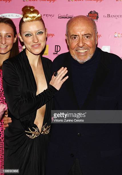 Miss Ania J and Elio Fiorucci attends the 'Candyland' by Elio Fiorucci Love Therapy show party held at Le Banque on February 10 2012 in Milan Italy