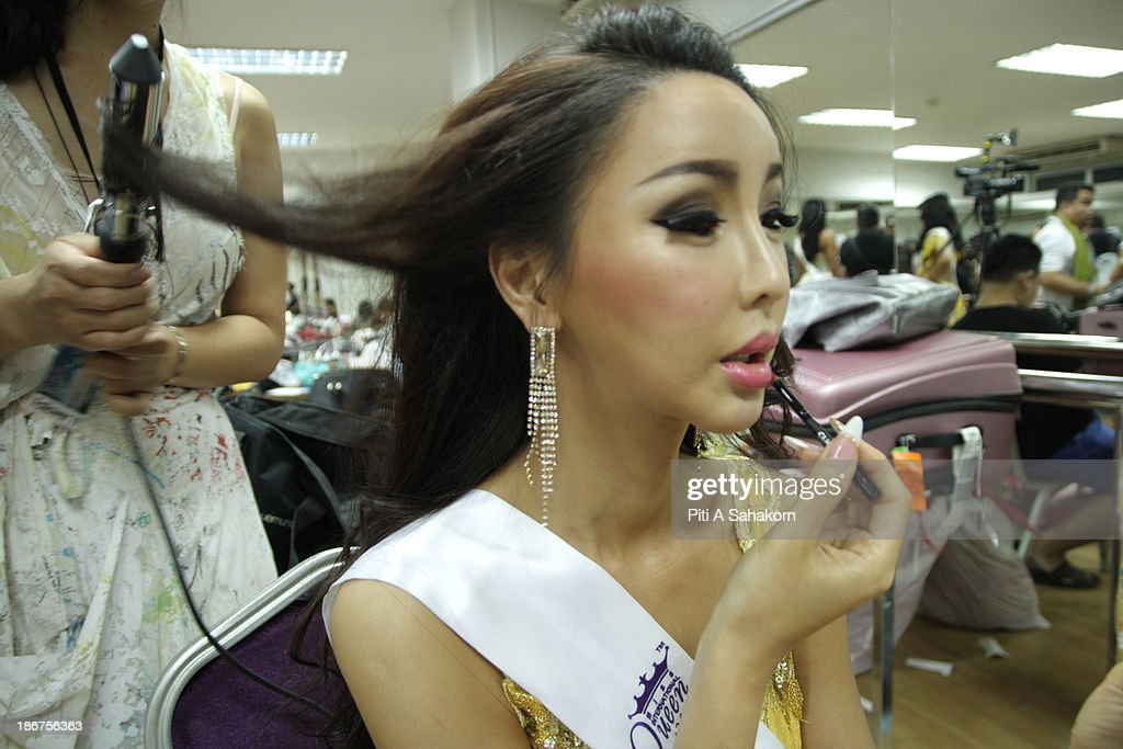 Miss Arisa from South Korea prepares and makes up backstage for the transvestite and transgender beauty pageant Miss International Queen 2013 at Tiffany's Show theatre in Pattaya city. Twenty-five contestants from 17 countries are participating in the event, which is endowed with prize money of 300,000 Thai baht (10,000 US dollars), a crown with real gems and a free surgery at a plastic surgery clinic in Bangkok..