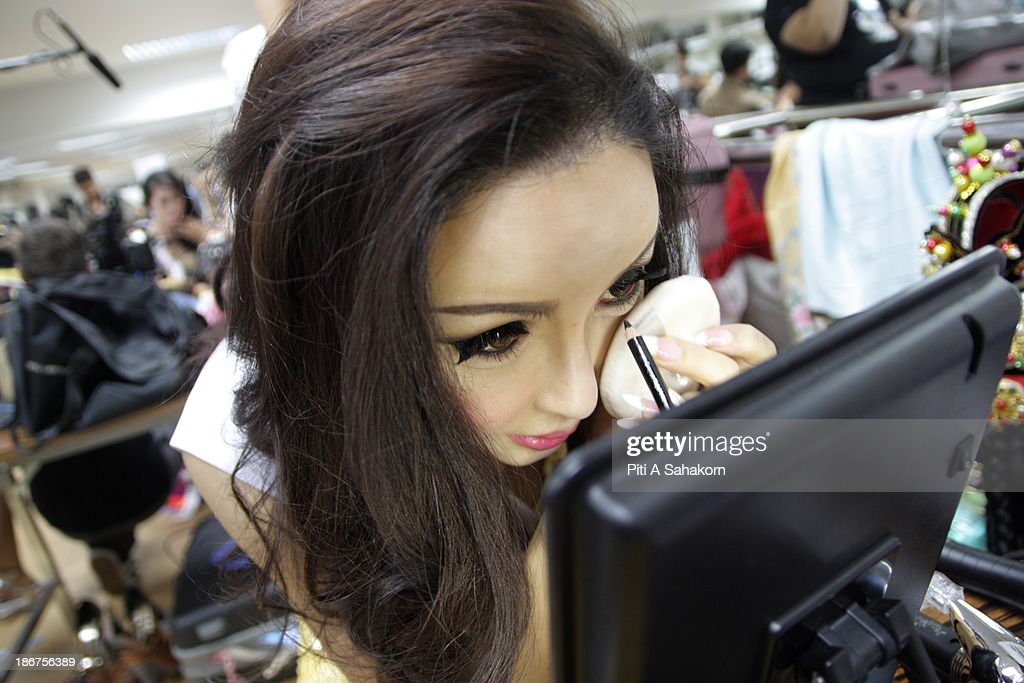 Miss Arisa from South Korea puts on make up backstage in the transvestite and transgender beauty pageant Miss International Queen 2013 at Tiffany's Show theatre in Pattaya city. Twenty-five contestants from 17 countries are participating in the event, which is endowed with prize money of 300,000 Thai baht (10,000 US dollars), a crown with real gems and a free surgery at a plastic surgery clinic in Bangkok..