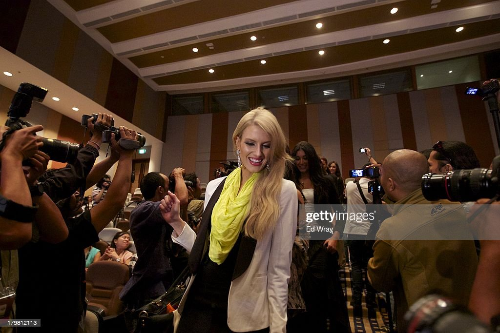 Miss Australia arrives at the opening press conference during the 2013 Miss World Pageant on September 7, 2013 in Denpasar, Bali, Indonesia. The Miss World contest has been protested by conservative Indonesian Muslim groups who object particularly to the Bikini swimwear portion of the competition which organizers have agreed to replace this year with a more modest beachwear competition including tradtional Indonesian batik sarongs.
