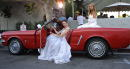 Miss Beverly Hills contestants Jennifer MacGregor left and Elizabeth Keatinge pose with a1964 Ford Mustang at the opening of 'James Dean New York...