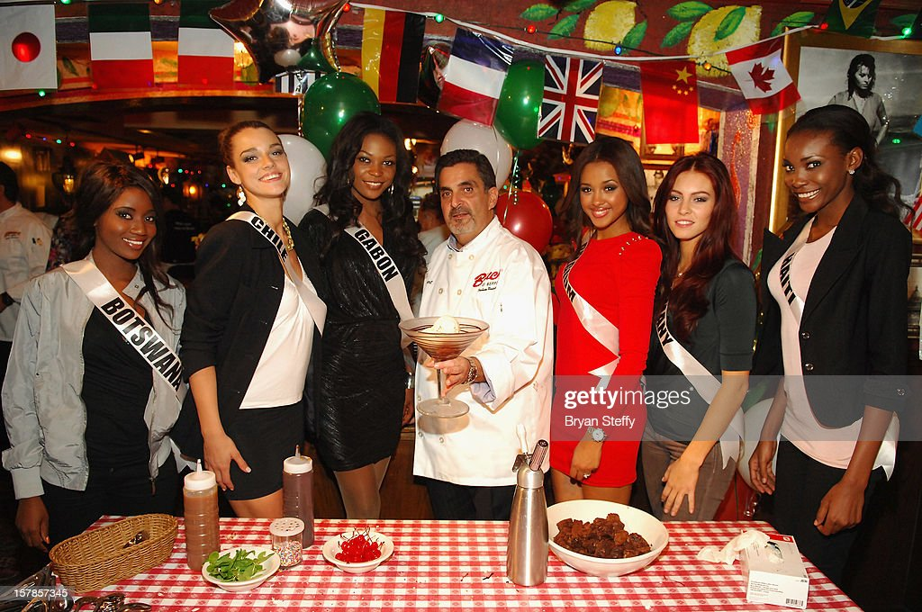Miss Botswana Sheillah Molelekwa Miss Chile Ana Luisa Konig, Miss Gabon Channa Divouvi, Chef Stuart Leitner, Miss Belgium Laura Beyne, Miss Germany Alicia Endermann and Miss Haiti Christela Jacques appear at the Buca di Beppo Italian Restaurant on December 6, 2012 in Las Vegas, Nevada.