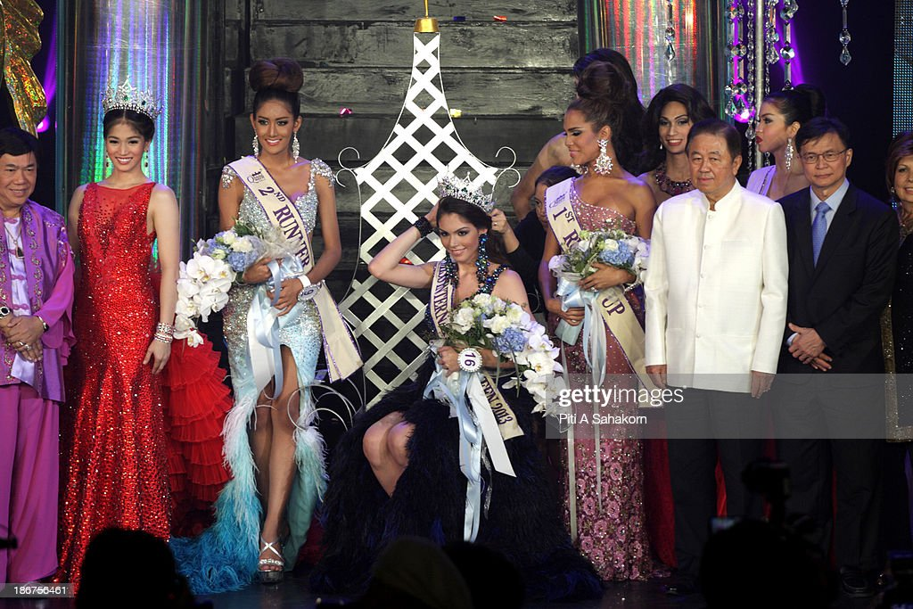 Miss Brazil, Marcelo Ohio (C), winner of the Miss International Queen 2013 transgender beauty pageant, with runner up Miss USA, Shantell D'Marco (L) and Miss Thailand, Nethnapada Kanrayanon second runner up on stage. Twenty-five contestants from 17 countries are participating in the event, which is endowed with prize money of 300,000 Thai baht (10,000 US dollars), a crown with real gems and a free surgery at a plastic surgery clinic in Bangkok..