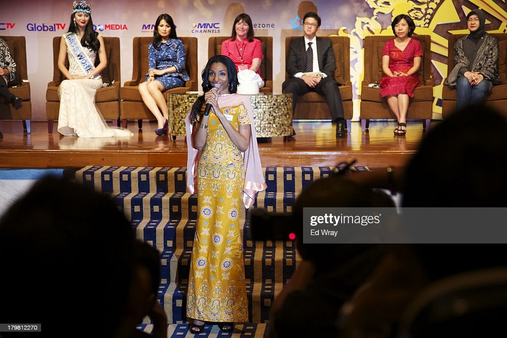 Miss Cameroon answers a question at the opening press conference during the 2013 Miss World Pageant on September 7, 2013 in Denpasar, Bali, Indonesia. The Miss World contest has been protested by conservative Indonesian Muslim groups who object particularly to the Bikini swimwear portion of the competition which organizers have agreed to replace this year with a more modest beachwear competition including tradtional Indonesian batik sarongs.