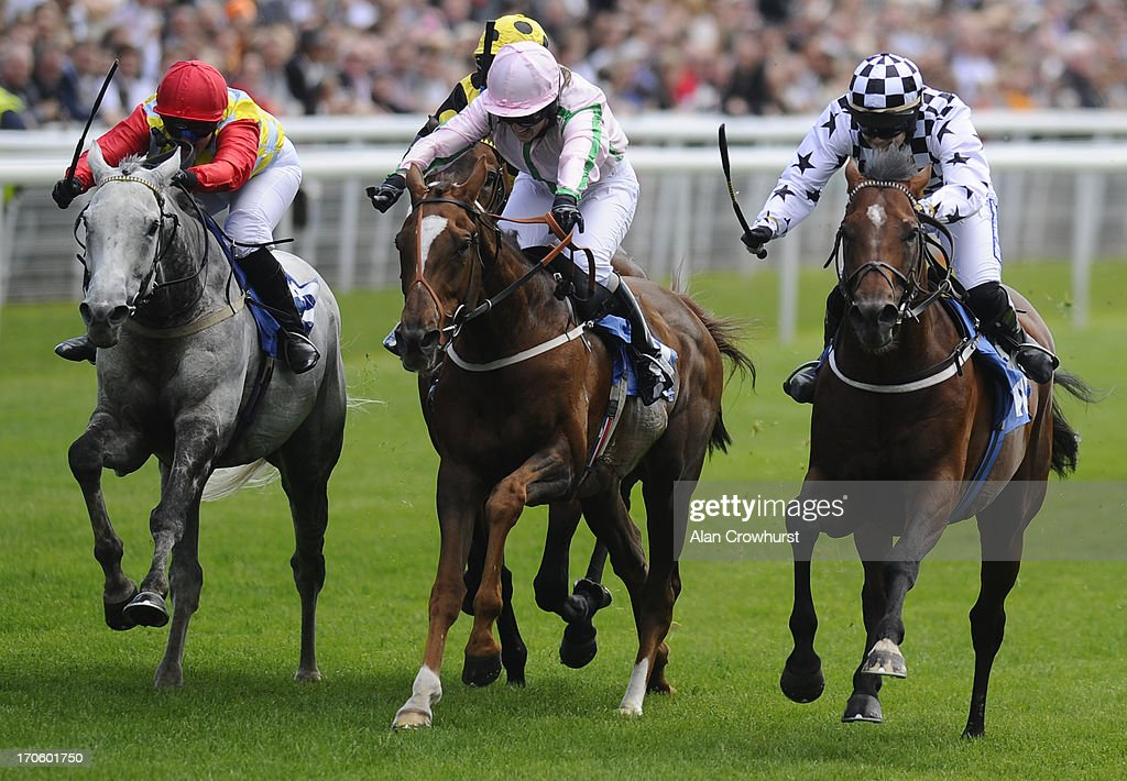 Miss Carol Bartley riding Nanton (L) win The Queen Mother's Cup at York racecourse on June 15, 2013 in York, England.